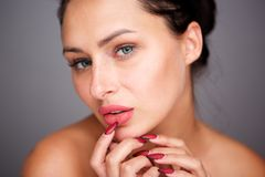 Close up beautiful woman with bare shoulders and flawless complexion. Close up portrait of beautiful woman with bare shoulders and flawless complexion royalty free stock image