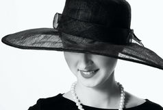 Close-up portrait of a beautiful woman in a black hat in retro s Stock Image