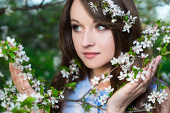 Close up portrait of beautiful woman in blooming cherry garden Royalty Free Stock Photography