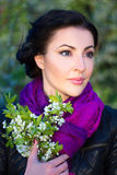 Close up portrait of beautiful woman with cherry tree flowers Royalty Free Stock Image