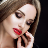 Close-up portrait of beautiful woman with clean skin bright makeup, red plump lips, highlighter, blush. Fashion, beauty Stock Image