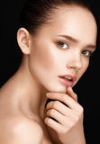 Close-up portrait of beautiful woman with clear healthy skin Stock Photos