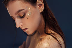 Close up portrait of beautiful woman with creative gold make up. Close up portrait of beautiful woman with gold make up Royalty Free Stock Photo