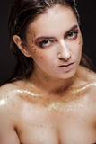 Close up portrait of beautiful woman with creative gold make up. Close up portrait of beautiful woman with gold make up Royalty Free Stock Photos