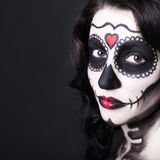 Close up portrait of beautiful woman with creative sugar skull m Stock Images