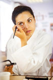 Close up portrait of a beautiful woman with eyebrow brush Royalty Free Stock Photo