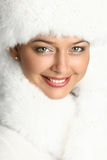Close-up portrait of a beautiful woman in fur cap Stock Image