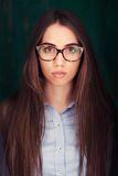 Close-up portrait of beautiful woman in glasses Stock Photos