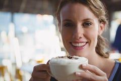 Portrait of beautiful woman having coffee royalty free stock photos