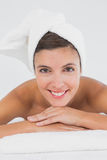 Close up portrait of a beautiful woman on massage table Stock Photos