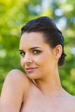 Close-up portrait of beautiful woman in park Stock Photos