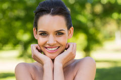Close-up portrait of beautiful woman in park Royalty Free Stock Photos