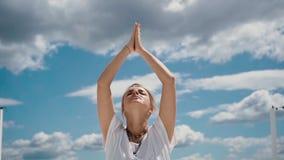 Close-up portrait of beautiful woman putting hands in namaste mudra posture. Close-up portrait of beautiful young woman putting hands in namaste mudra posture stock footage