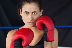 Close up portrait of a beautiful woman in red boxing gloves Stock Photos