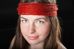 Close-up portrait of beautiful woman with red rope Stock Photos
