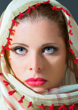 Close up portrait of beautiful  woman wearing scarf Stock Photo