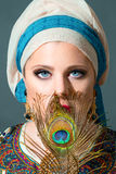 Close up portrait of beautiful  woman wearing turban Royalty Free Stock Images