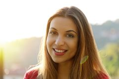 Close-up portrait of beautiful young adult woman in the sunlight at sunset. Pretty smiling girl. Beautiful woman is enjoying warm royalty free stock photos