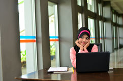 Close-up portrait of beautiful young Asian student with laptop Royalty Free Stock Photography