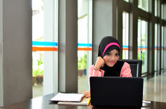 Close-up portrait of beautiful young Asian student with laptop Royalty Free Stock Photos