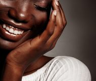 Close up portrait of beautiful young black woman laughing. Life style and people concept: Close up portrait of beautiful young black woman laughing Stock Photos