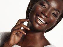 Close up portrait of beautiful young black woman laughing. Life style and people concept: Close up portrait of beautiful young black woman laughing Royalty Free Stock Image