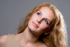 Close-up portrait of a beautiful young charming girl watching up Royalty Free Stock Photos