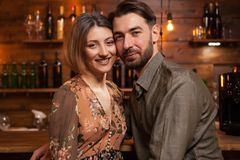 Close up portrait of beautiful young couple in a cozy pub royalty free stock photo