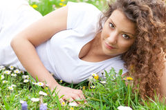 Close up portrait of beautiful young girl in flower field Stock Images