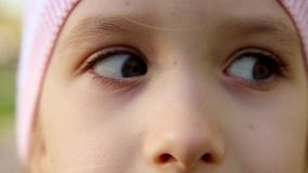 Close up portrait of the beautiful young girl of a little girl eye open. stock video