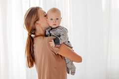 Mother kissing and hugging baby royalty free stock images