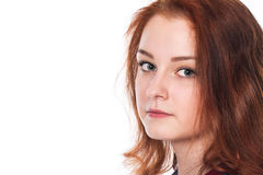 Close-up portrait of a beautiful young red-haired girl looking a Stock Photos