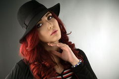 Close up portrait of a beautiful young redhead woman Stock Photography