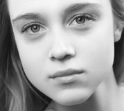 Close up portrait of beautiful young woman. Black and white portrait of beautiful young woman royalty free stock image