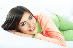 Close up portrait of beautiful young woman in bed. Smiling  dre Royalty Free Stock Photography