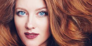 Portrait of beautiful young woman with big blue eyes, berry lips and brazen hair. Close up portrait of beautiful young woman with big blue eyes, berry lips and Stock Photography