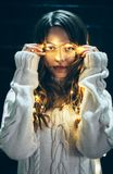 Close up portrait of a beautiful young woman with christmas ligh Royalty Free Stock Photos