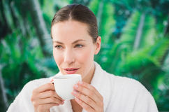 Close up portrait of a beautiful young woman drinking a coffee Royalty Free Stock Images