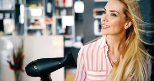 Portrait of beautiful young woman drying hairstyle. Close up portrait of beautiful young woman drying hairstyle stock photography