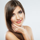 Close up portrait of beautiful young woman face. Isolated Stock Photography