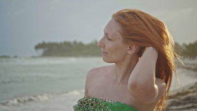 Close up portrait of beautiful young woman with freckles take off the hat on tropical beach slow motion, Dominican. Republic, Juan Dolio stock footage