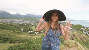 Close up portrait of beautiful young woman with hat at Pillbox Hike, Hawaii stock video footage
