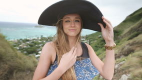 Close up portrait of beautiful young woman with hat at Pillbox Hike, Oahu stock footage