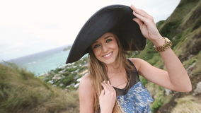 Close up portrait of beautiful young woman with hat at Pillbox Hike, Oahu stock video footage