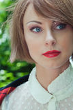 Close-up portrait of beautiful young woman in horsewoman suit in Stock Photography