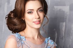 Close-up portrait of beautiful young woman in luxury dress, pastel color Royalty Free Stock Image