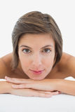 Close up portrait of a beautiful young woman on massage table Stock Images