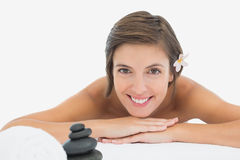 Close up portrait of a beautiful young woman on massage table Royalty Free Stock Image