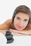 Close up portrait of a beautiful young woman on massage table Stock Image