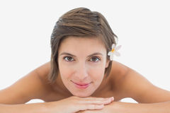 Close up portrait of a beautiful young woman on massage table Stock Photos